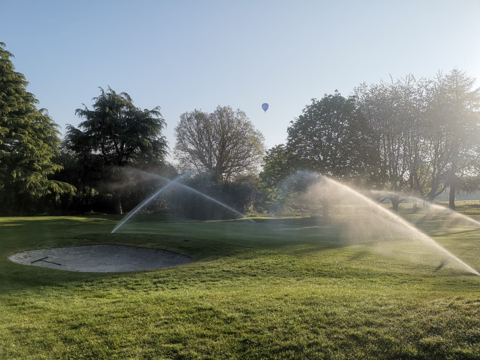 View of Irrigation system sprinklers for golf course